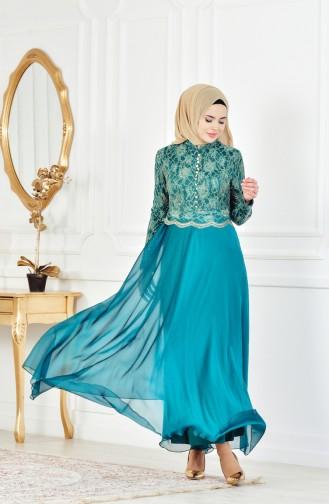 فستان سهرة بتفاصيل من الدانتيل 7960-04 لون اخضر زُمردي 7960-04