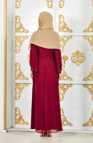 فستان سهرة يتميز بتفاصيل من الدانتيل 1284-01 لون خمري 1284-01