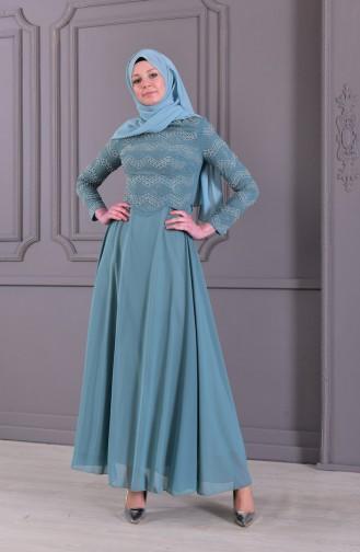 فستان سهرة بتفاصيل من اللؤلؤ واحجار لامعة 8502-03 لون اخضر 8502-03